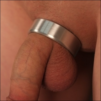 Putting on a wide stainless steel cock ring